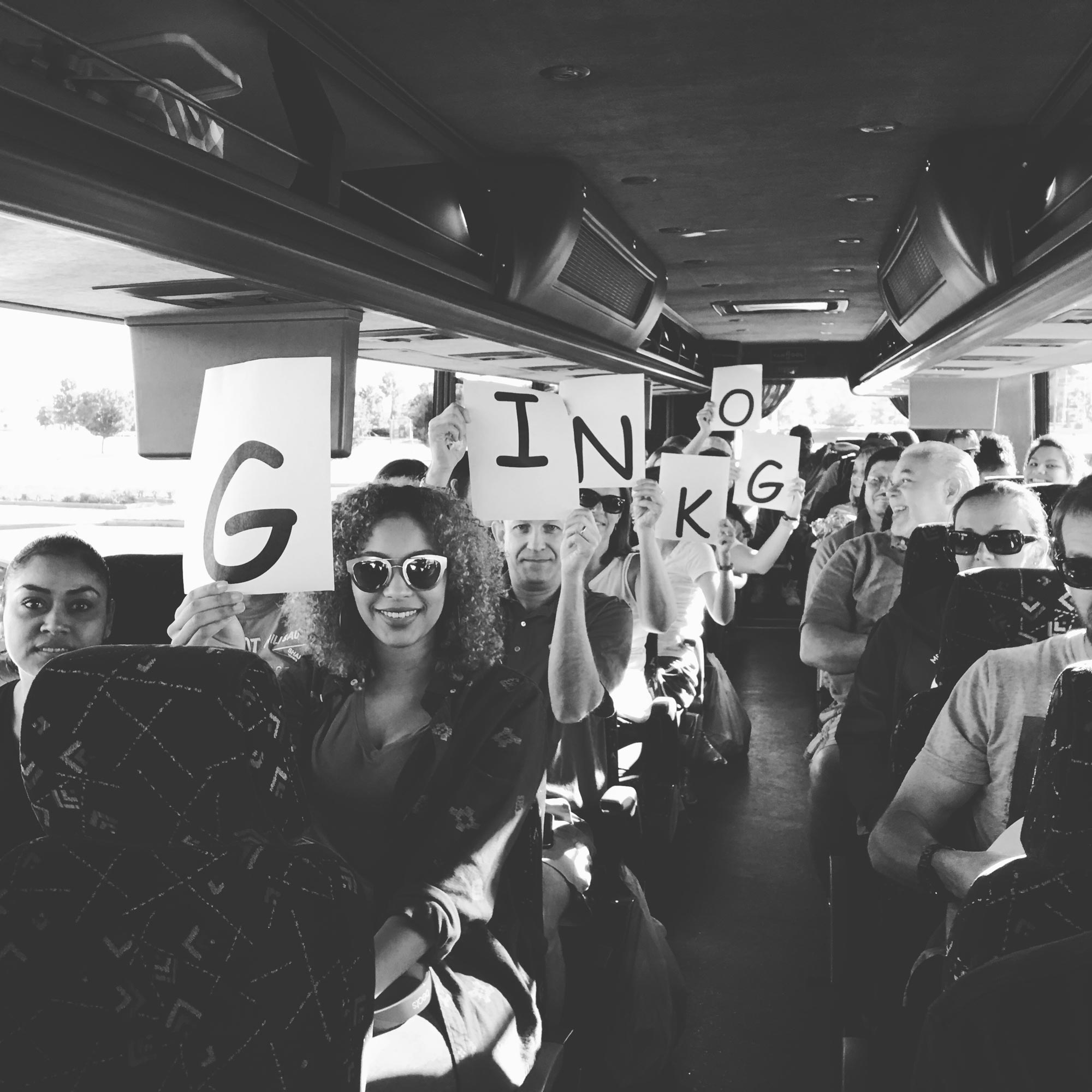 Ginkgo Residential | People Holding Up Signs in a Bus That Spell Out Ginkgo